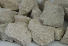 Камінь твердий, вапняно-доломітовий, темно-сірий,