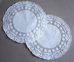 Napkins openwork diameter are 23 cm