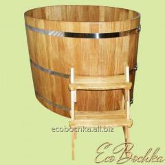 The oval font from an oak, a wooden bathtub, a
