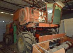 (A harvester + the cart and a sorter) to buy the