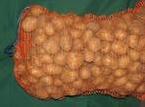 Картофель, затареный в сетку ручной переборки