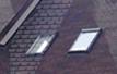 Окна мансардные с центральной осью, с поднятой
