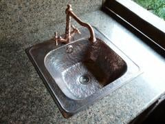 Copper sinks. Wash basins from copper. A sink