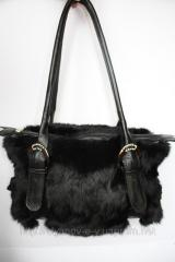 Fashions 102. A women bag from fur of a black