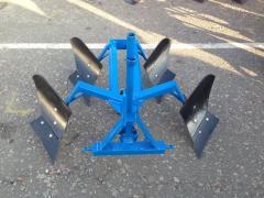 Reverse hinged plow