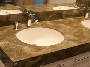 Wash basins and sinks from an artificial stone