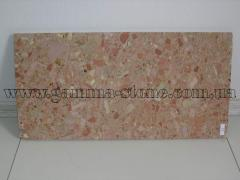 Tile from a conglomerate