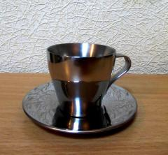 Cup and saucer for espresso from the stainless