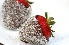 Strawberry in dark chocolate is covered with