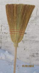 The broom of a sorghum on the wooden handle in