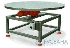 Table vibration rotating for filling of cans,