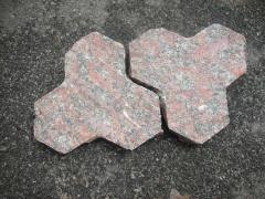 Stone blocks sidewalk granite figured with the