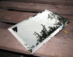 The tile is green, bronze, graphite a triangle 250