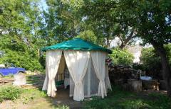 Awning and curtains on a garden arbor