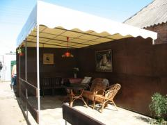 Canopy from the sun over terassy in the yard and