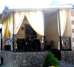 Classical curtains on a terrace