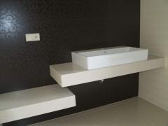 Table-top for a bathroom, a table-top in a