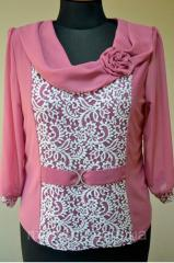 Female blouse with guipure and a chiffon sleeve of