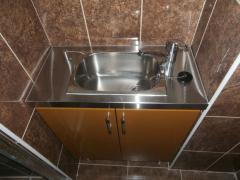 Sink. Built-in doser of soap.