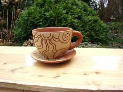 Ceramic cup with a saucer