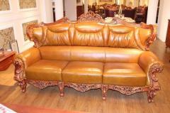 Leather oak sofa in classical style.