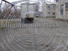 Barbed wire the Fidget, a mobile barrier, an