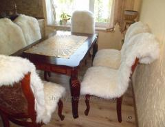 Cape on a chair from a sheepskin, white 53