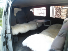 Cape on an automobile seat, a sheepskin 38
