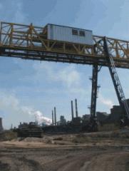 Мостовые грейферные перегружатели для