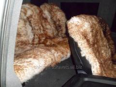 Automotive cape of sheepskin