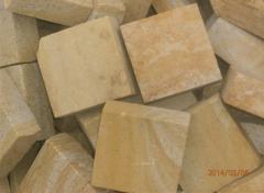 Stone blocks sidewalk of a stone of sandstone of