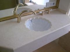 Table-top from a natural stone under a wash basin