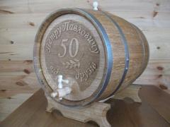 Barrels with a manual carving on a gift, a volume