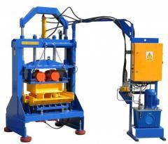 Vibrating press for slag stones, a stone blocks,