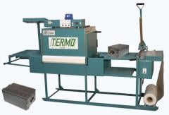Thermopacking machine of type through passage with