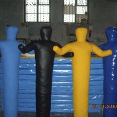 The dummy is wrestling. Dummies (effigies) for