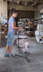 The tandoor ceramic with an okovka