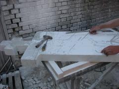 Making marble cross in the shop OOO Pryadko