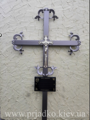 Cross on a grave the Cross welded ritual with