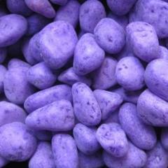 Decorative stone of violet color for lanshaftny