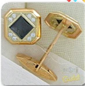 Man's cuff links from gold