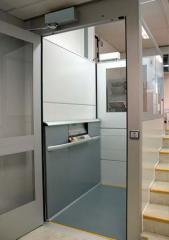 Vertical elevators for disabled people
