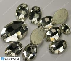 Mm Crystal 11/16. Ovals with a flat bottom.