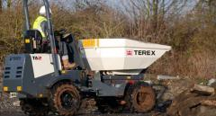 The Terex TA2 mini-dump truck with the Power Tip function (for movement of bulks).
