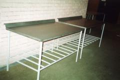 Finishing tables from stainless steel