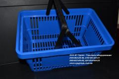 Basket plastic consumer in shop. Baskets of the