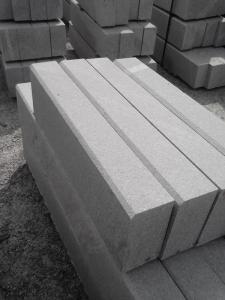 Borders granite.