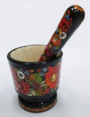 The mortar is wooden souvenir