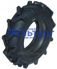 The tire F-140M 6L-12 on the motor-block
