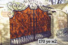 Gate 21 deaf with elements of artistic forging